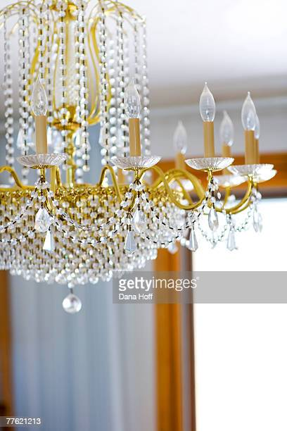 an exquisite chandelier is seen under a white ceiling - dana white stock pictures, royalty-free photos & images