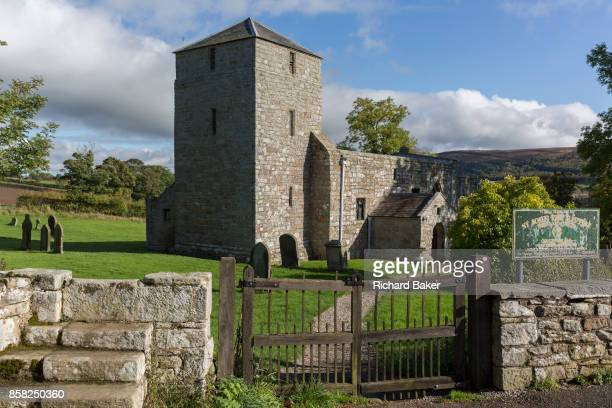 An exterior of St. John the Baptist Church in Edlingham with its fortified belfry to repel cross-border rievers, on 28th September 2017,...