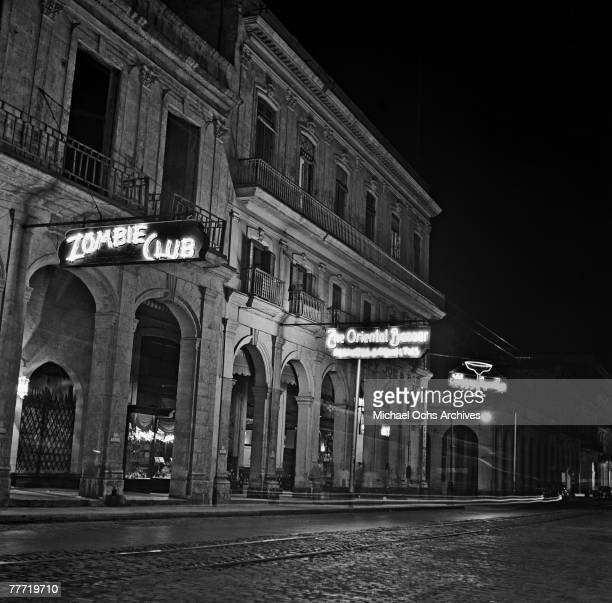 An exterior of Zulueta Street showing Sloppy Joe's Bar, The Oriental Bazaar and the Zombie Club in 1946 in Havana, Cuba. Both food historians and...