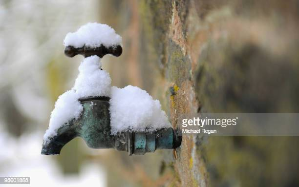 An exterior tap is covered in snow in Newtown Linford on January 6, 2010 in Leicestershire, United Kingdom. The MET Office has put in place severe...
