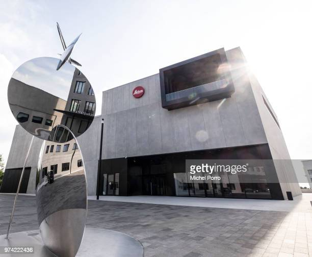 An exterior view of a building resembling a Leica rangefinder camera at the corporate headquarters of Leica Camera AG designed by Gruber...