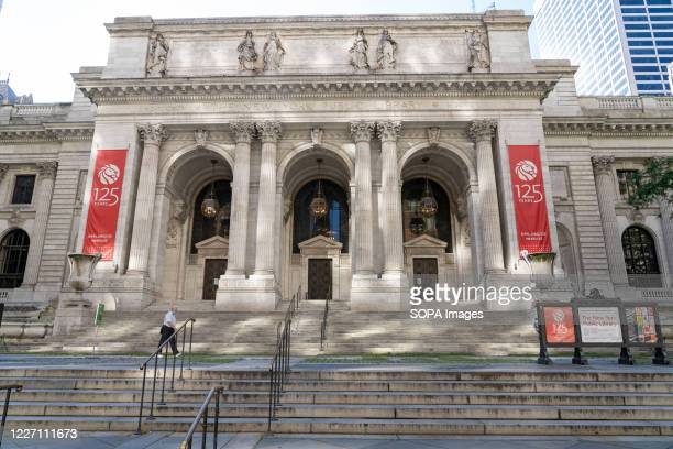 An exterior view of New York Public Library on Fifth Ave in New York. The New York Public Library's stone lions Patience and Fortitude have donned...
