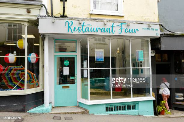 An exterior view of Restaurant Four, which has closed due to Covid restrictions on June 25, 2021 in Falmouth, England. Notifications from the NHS...