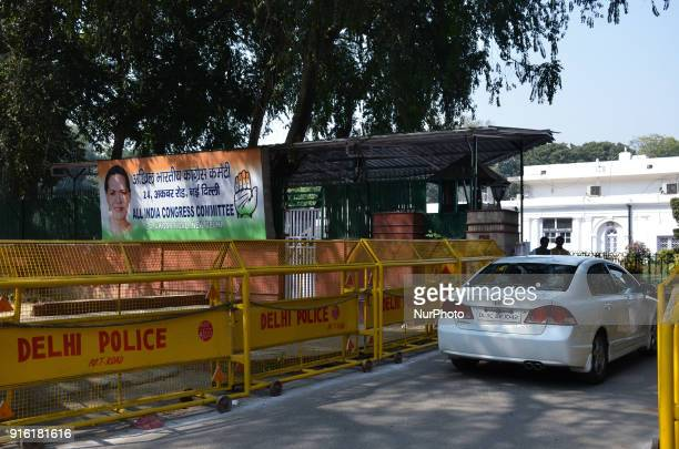 An exterior view of the All India Congress Committee office situated along Akbar Road in New Delhi. Victims and their family members gather along...