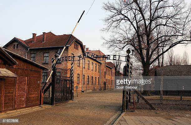 "An exterior view of The Auschwitz complex, December 8, 2004 showing the entrance gates to Auschwitz I with the words ""Arbeit Macht Frei"" over head...."