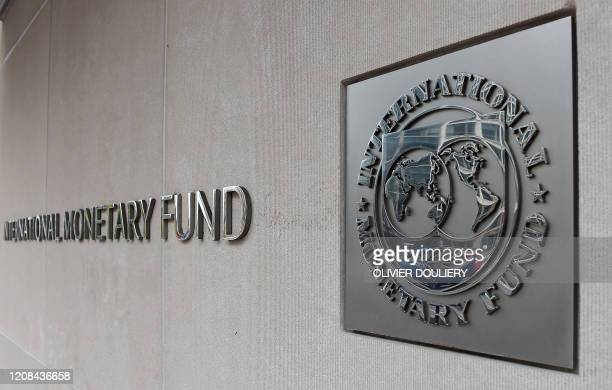 An exterior view of the building of the International Monetary Fund , with the IMG logo, is seen on March 27, 2020 in Washington, DC. - The...