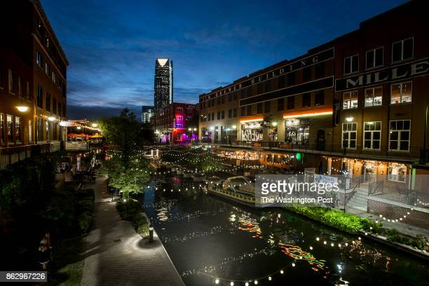 An exterior view of the canal through Bricktown with the Devon Tower in the background in Oklahoma City Oklahoma on October 02 2017