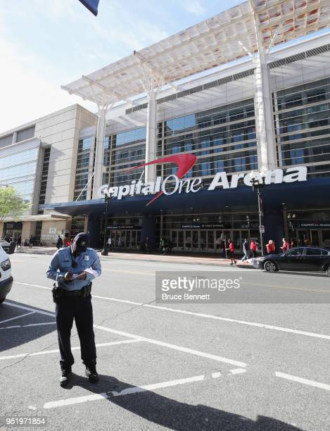 An exterior view of the Capital One Arena with a police officer writting a parking ticket prior to the game between the Washington Capitals and the...