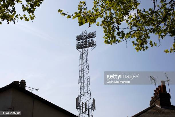 An exterior view of the ground's floodlight pylons pictured before Brentford hosted Leeds United in an EFL Championship match at Griffin Park. Formed...