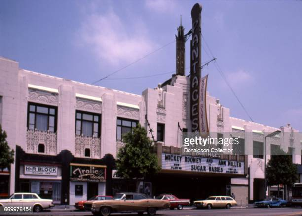 An exterior view of the Pantages Theater next to an H and R Block and the Frolic Room bar featured on the marquee was Mickey Rooney and Ann Miller in...