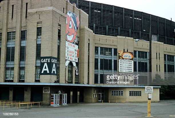 An exterior view of the stadium showing the mascot logos for the Cleveland Indians and the Cleveland Browns with the schedules for upcoming games...