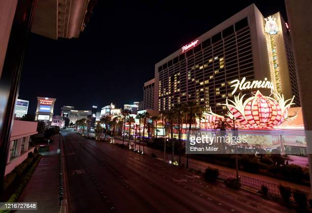 "An exterior view shows a nearly empty Las Vegas Strip below guest rooms at the shuttered Flamingo Las Vegas illuminated to spell out a ""We love..."