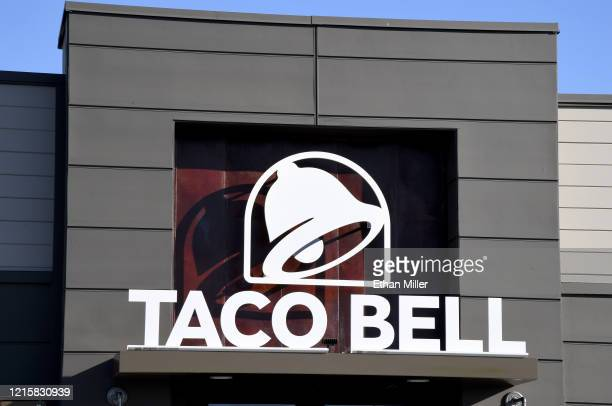 An exterior view shows a sign at a Taco Bell restaurant on March 30 2020 in Las Vegas Nevada Taco Bell Corp announced that on March 31 the company...