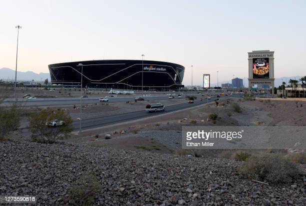 An exterior view shows Allegiant Stadium the USD 2 billion000seat home of the Las Vegas Raiders west of a marquee at Mandalay Bay Resort and Casino...