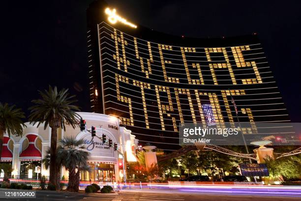 """An exterior view shows guest rooms at Wynn Las Vegas illuminated to spell out """"#VEGAS STRONG"""" as the resort remains closed as a result of the..."""