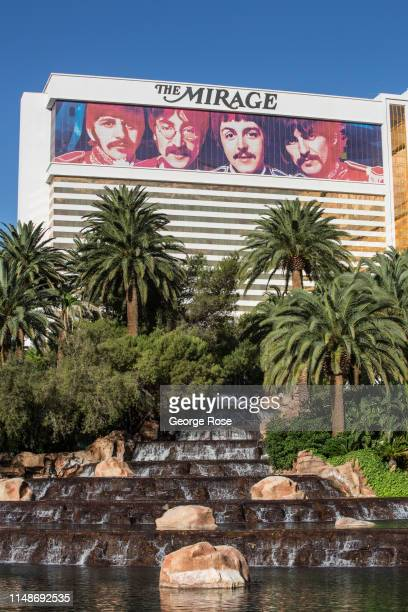 An exterior waterfall with palm trees at The Mirage Hotel & Casino is viewed on May 8, 2019 in Las Vegas, Nevada. As temperatures begin to heat up,...