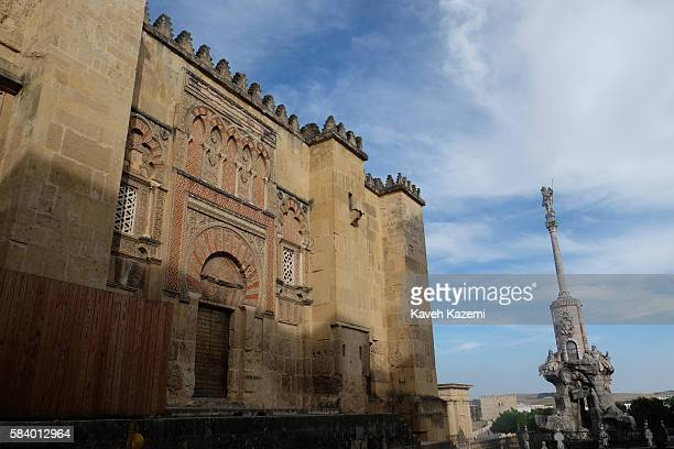 An external view of famous mosque with Triunfo de San Rafael column on June 26 2016 in Cordoba Spain La Mezquita an immense mosque dating to 600 CE...