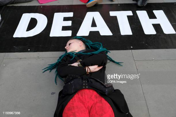 An Extinction Rebellion activist staged a diein outside the Royal Opera House main entrance during a protest in London Environmental Activists from...