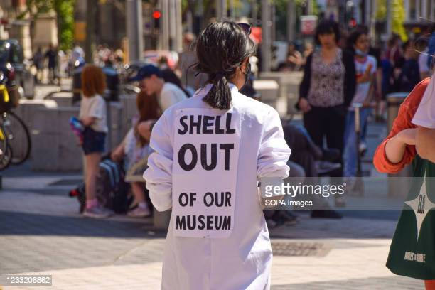 An Extinction Rebellion activist stands outside the Science Museum in London during the anti-Shell protest. The activists gathered outside the museum...