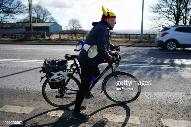 An Extinction Rebellion demonstrator wears a viking helmet and carries a megaphone as he rides his bike on the second day of a threeday mass action...