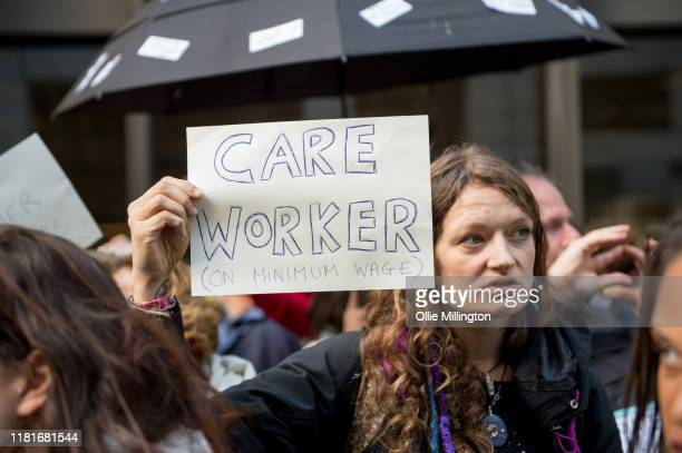 An Extinction Rebellion environmental activist and Care Worker protests outside the offices of The Department of Working Pensions on October 17, 2019...