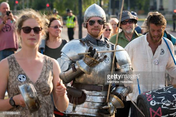 An Extinction Rebellion protestor dressed as a knight outside Cardiff city hall as the environmental protest group ends day two of a series of...