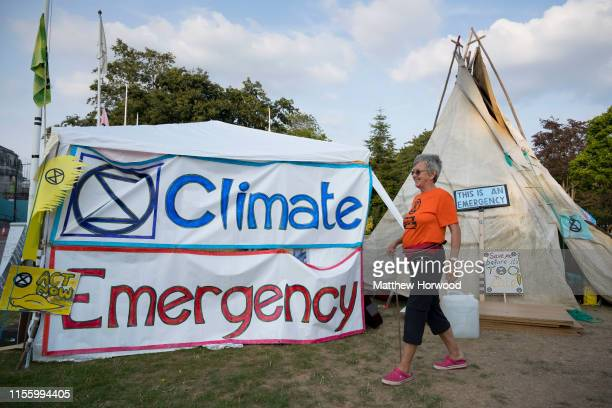 An Extinction Rebellion protestor walks through the protestor camp outside Cardiff city hall as the environmental protest group ends day two of a...