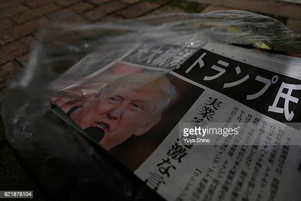 An extra edition of a newspaper featuring a front page report on the US Presidential Election and Republican Presidentelect Donald Trump is seen on a...