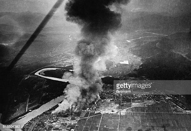 An extraordinary view from an airplane of the devastated and burning section of Tokyo the result of the recent fatal earthquake Hundreds were killed...