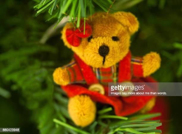 An extreme close up of a Christmas tree decoration. A small bear.