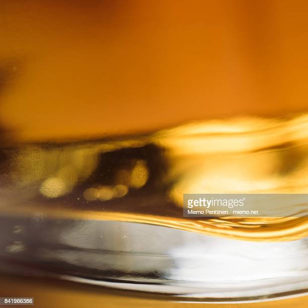 an extreme close-up shot of a whiskey glass - whisky stock photos and pictures