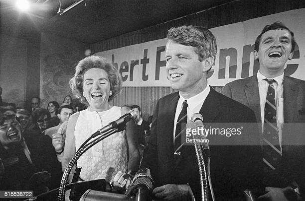 An exuberant Senator Robert F Kennedy and Mrs Kennedy happily face an enthusiastic cheering throng at campaign headquarters here after Kennedy won...