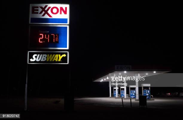 An Exxon Mobil Corp gas station stands illuminated at night in Nashport Ohio US on Friday Jan 26 2018 Exxon Mobil Corp is scheduled to release...