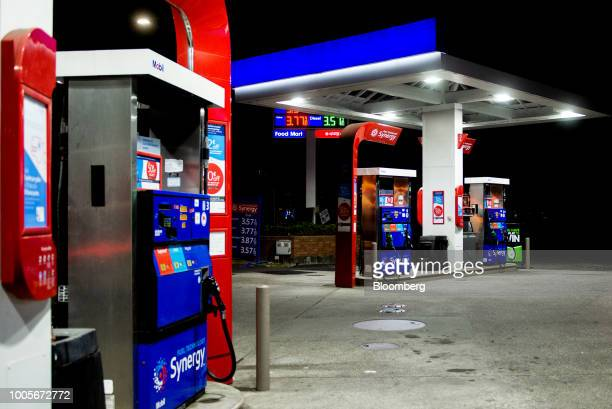 An Exxon Mobil Corp gas station stands illuminated at night in Seattle Washington US on Tuesday July 24 2018 Exxon Mobil Corp is scheduled to release...