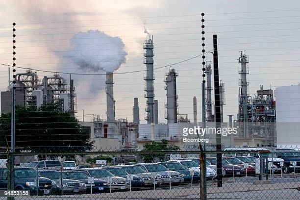 An Exxon Mobil Corp refinery stays in operation in Baton Rouge Louisiana on Sunday Aug 31 2008 At least eight refineries are shutting taking with...