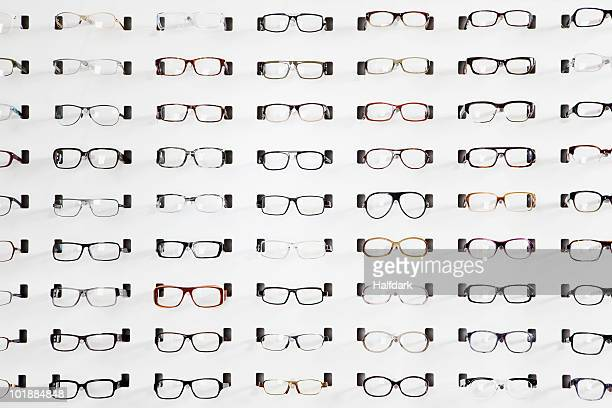 an eyeglasses display in an eyewear store - eyewear stock pictures, royalty-free photos & images