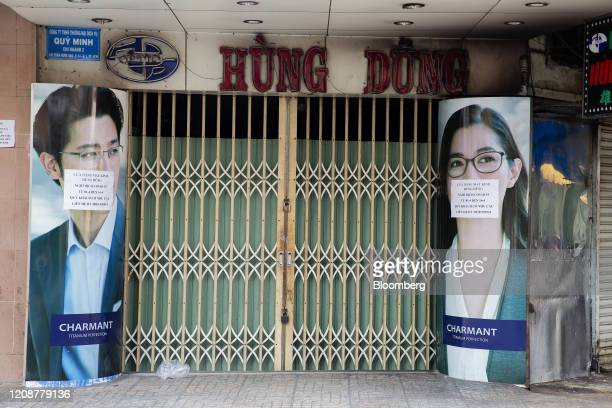 An eyeglasses store stands shuttered during a partial lockdown imposed due to the coronavirus in Ho Chi Minh City Vietnam on Wednesday April 1 2020...