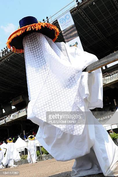 An Eyo masquerade parades during the celebration of Eyo festival in Lagos on November 26 2011 The Adamu Orisa play otherwise known as Eyo festival a...