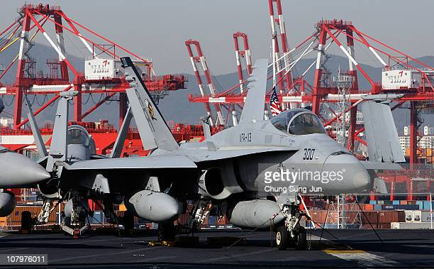 An F 18 Hornet aircraft on the flight deck of Aircraft Carrier USS Carl Vinson whilst at anchor in Busan port on January 11 2011 in Busan The USS...