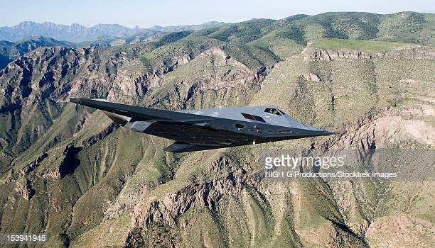 an f-117 nighthawk from the 53d test and evaluation group's detachment 1 flies a training sortie near holloman air force base, new mexico. - stealth bomber stock photos and pictures