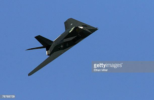 An F117A Nighthawk flies by during a US Air Force firepower demonstration at the Nevada Test and Training Range September 14 2007 near Indian Springs...