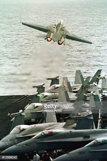 An F14 takes off from the flightdeck.