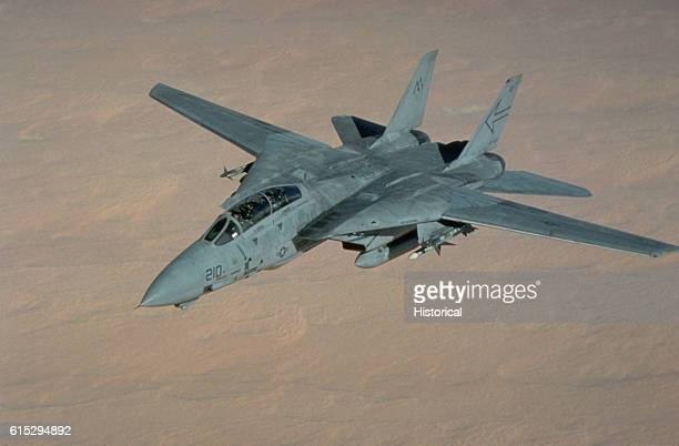 An F14 Tomcat aircraft of Fighter Squadron 103 prepares for refueling during Operation Desert Storm The aircraft is armed with AIM7 Sparrow and AIM9...