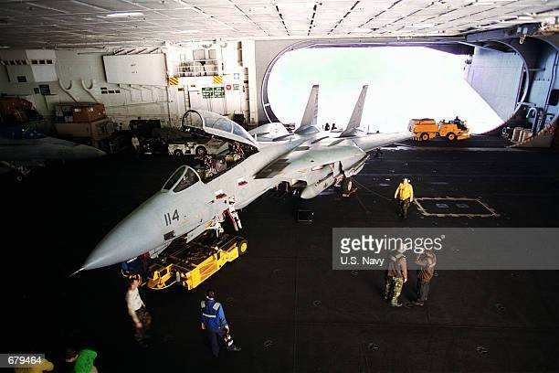 An F14 Tomcat is parked for maintenance in a hangar bay November 3 2001 on board the aircraft carrier USS Theodore Roosevelt The Theodore Roosevelt...