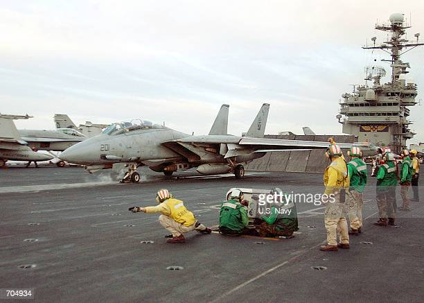 An F14 Tomcat prepares to launch March 19 2002 from the flight deck of the aircraft carrier USS John F Kennedy The Kennedy is conducting combat...
