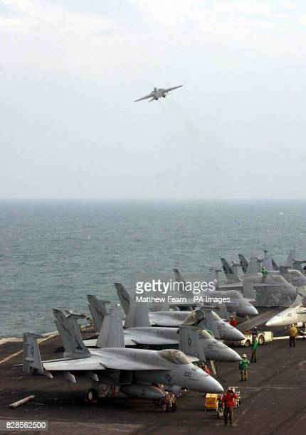 An F14 Tomcat takes off from the flight deck of the USS Abraham Lincoln The Lincoln is currently in the Arabian Gulf enforcing the nofly zones over...