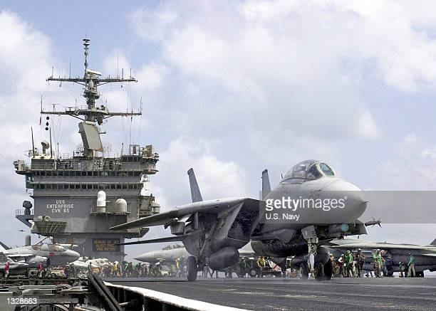 An F14A jet taxis September 17 2001 to takeoff from the USS Enterprise Navy personnel are preparing for possible strikes against terrorist sites in...