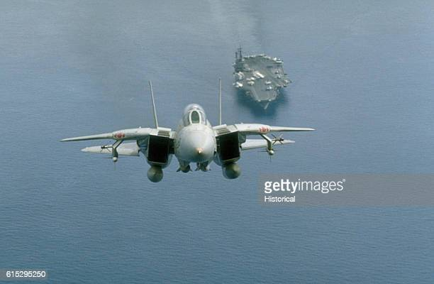 An F14A Tomcat aircraft from Fighter Squadron 102 just after taking off from the aircraft carrier USS America The aircraft is armed with two AIM54...