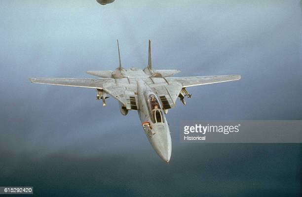 An F14A Tomcat aircraft from Fighter Squadron 32 extends its refueling probe after falling in behind an Air Force KC135 Stratotanker aircraft to...