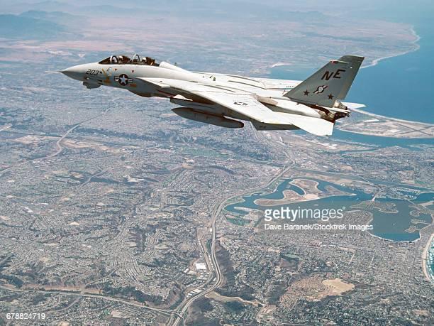 An F-14A Tomcat cruises above San Diego, California.
